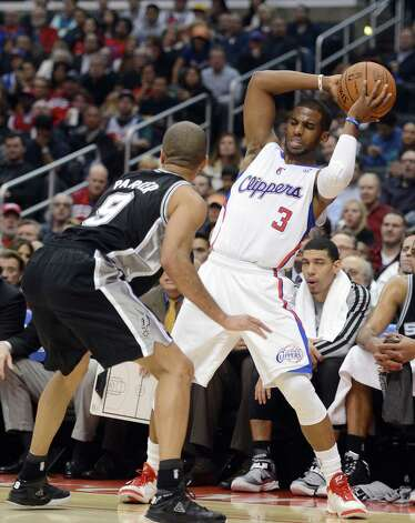The Clippers' Chris Paul (right) tries to keep the ball away from Tony Parker of the Spurs on Thursday night. Parker had his way in the point guard matchup, which was reflected in the final score. Photo: Harry How / Getty Images