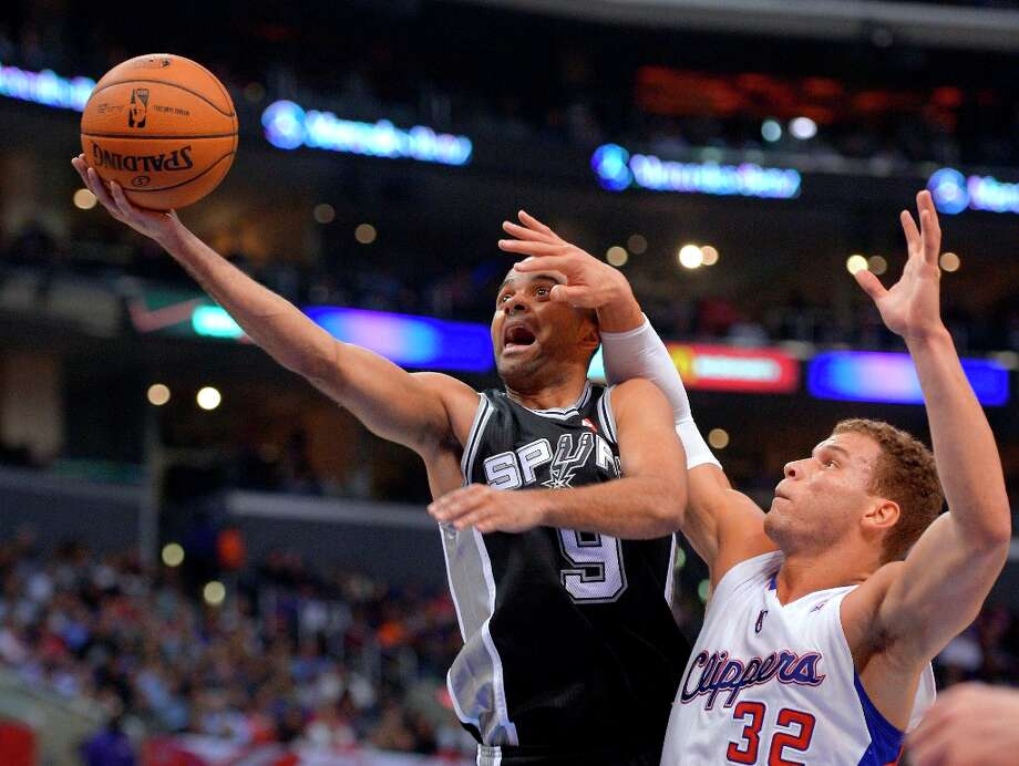 Spurs guard Tony Parker, left, goes up for a shot as Clippers forward Blake Griffin defends during the first half, Thursday, Feb. 21, 2013, in Los Angeles. Photo: Mark J. Terrill, Associated Press / AP
