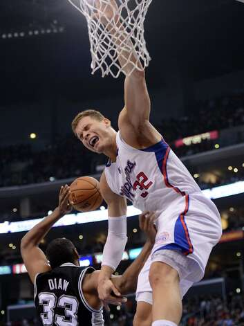 Blake Griffin #32 of the  Clippers is fouled under the basket by Boris Diaw #33 of the Spurs at Staples Center on February 21, 2013 in Los Angeles, California. Photo: Harry How, Getty Images / 2013 Getty Images