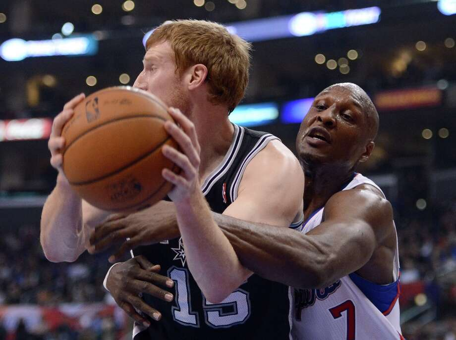 Lamar Odom #7 of the Clippers fouls Matt Bonner #15 of the  Spurs on a reach in at Staples Center on February 21, 2013 in Los Angeles, California. Photo: Harry How, Getty Images / 2013 Getty Images