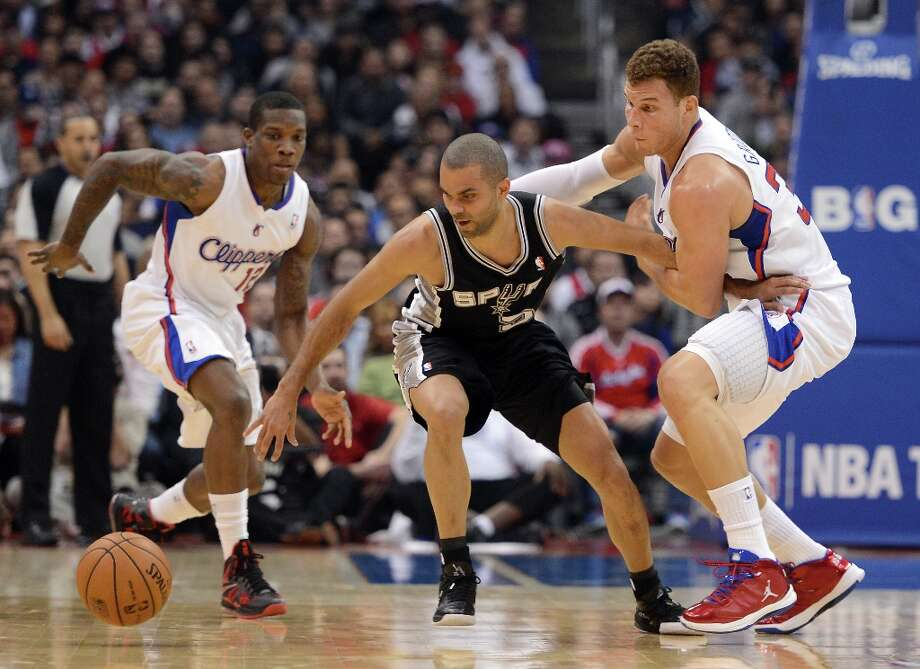 Tony Parker #9 of the Spurs is fouled by Blake Griffin #32 of the Clippers in front of Eric Bledsoe #12 at Staples Center on February 21, 2013 in Los Angeles, California. Photo: Harry How, Getty Images / 2013 Getty Images