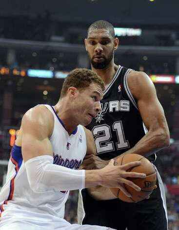 Blake Griffin #32 of the Clippers drives on Tim Duncan #21 of the Spurs at Staples Center on February 21, 2013 in Los Angeles, California. Photo: Harry How, Getty Images / 2013 Getty Images