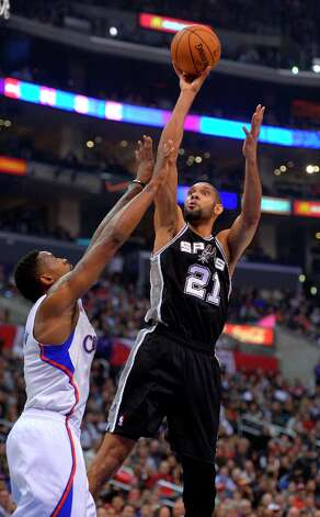 Spurs forward Tim Duncan, right, puts up a shot as Clippers center DeAndre Jordan defends during the first half  Thursday, Feb. 21, 2013, in Los Angeles. Photo: Mark J. Terrill, Associated Press / AP