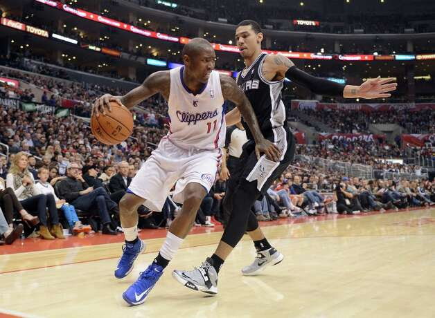 Jamal Crawford #11 of the Clippers looks to dribble around Danny Green #4 of the Spurs at Staples Center on February 21, 2013 in Los Angeles, California. Photo: Harry How, Getty Images / 2013 Getty Images