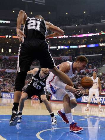Blake Griffin #32 of the  Clippers has the ball kicked out of his hands by Tim Duncan #21 of the  Spurs at Staples Center on February 21, 2013 in Los Angeles, California. Photo: Harry How, Getty Images / 2013 Getty Images