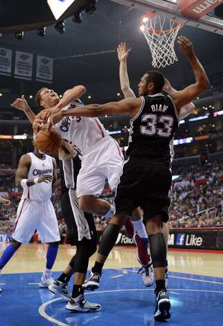 Blake Griffin #32 of the Clippers has the ball knocked away by Boris Diaw #33 of the Spurs at Staples Center on February 21, 2013 in Los Angeles, California. Photo: Harry How, Getty Images / 2013 Getty Images