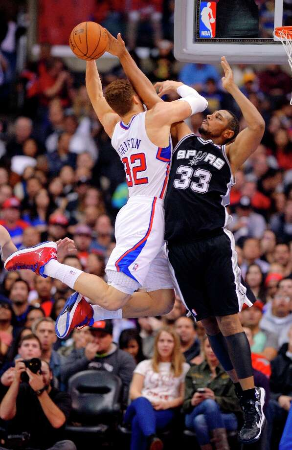 Spurs center Boris Diaw, right, blocks the shot of Clippers forward Blake Griffin during the first half   Thursday, Feb. 21, 2013, in Los Angeles. Photo: Mark J. Terrill, Associated Press / AP