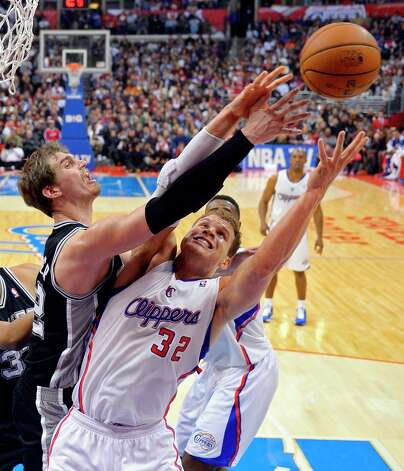 Spurs center Tiago Splitter, left, and Clippers forward Blake Griffin go after a rebound during the first half  Thursday, Feb. 21, 2013, in Los Angeles. Photo: Mark J. Terrill, Associated Press / AP