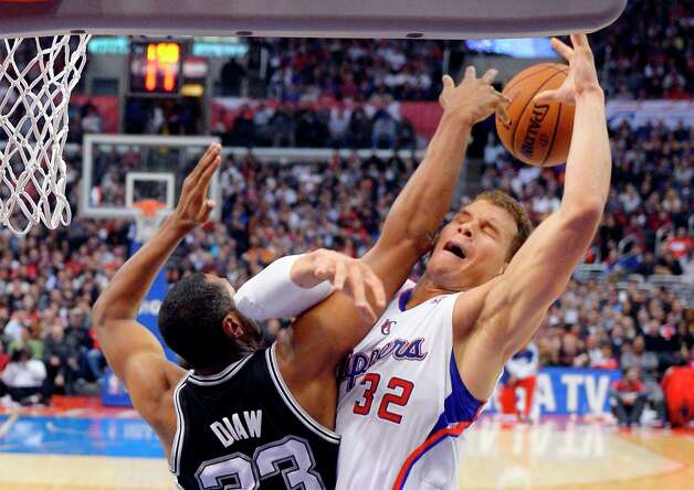 Spurs center Boris Diaw, left, blocks the shot of Clippers forward Blake Griffin during the first half  Thursday, Feb. 21, 2013, in Los Angeles. Photo: Mark J. Terrill, Associated Press / AP