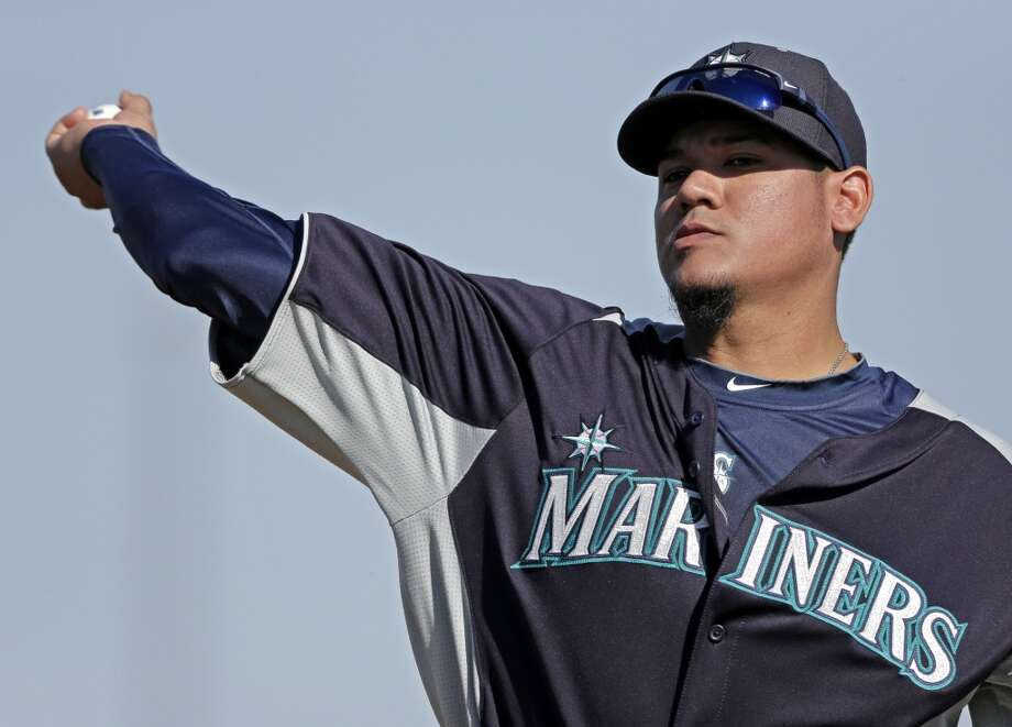 Mariners pitcher Felix Hernandez throws during a spring training workout Monday in Peoria, Ariz.