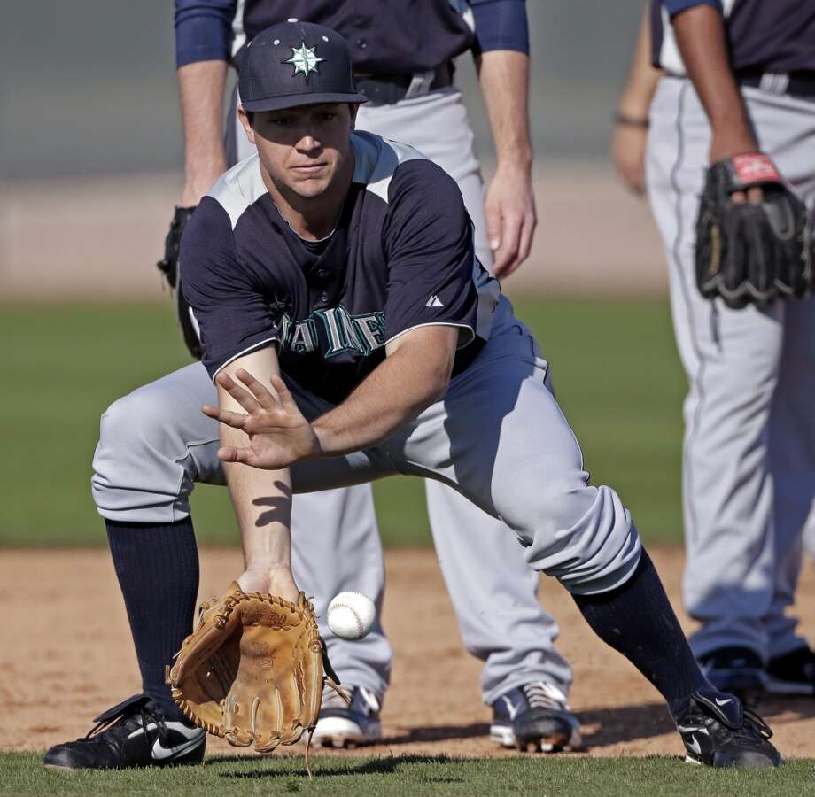 Mariners pitcher Danny Hultzen fields a ground ball during a spring training workout Monday in Peoria, Ariz.