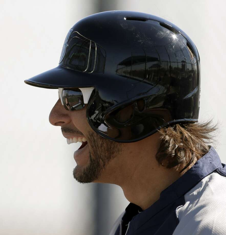 Mariners outfielder Michael Morse laughs with teammates during a spring training workout Tuesday in Peoria, Ariz.