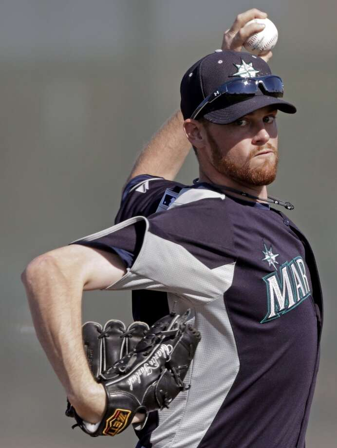 Seattle Mariners pitcher Charlie Furbush throws during a baseball spring training workout Monday in Peoria, Ariz.