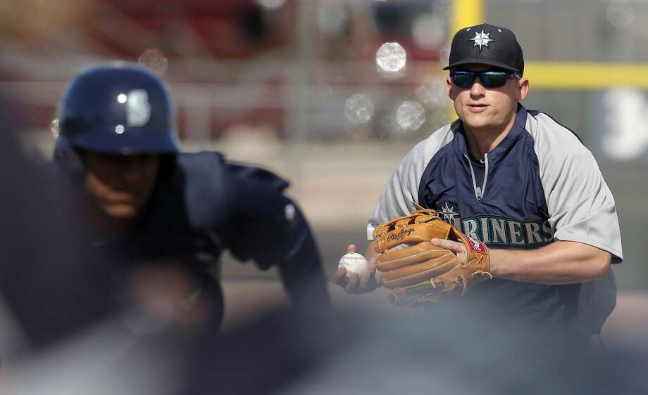 Mariners third baseman Kyle Seager chases down a baserunner during a spring training workout Tuesday in Peoria, Ariz.