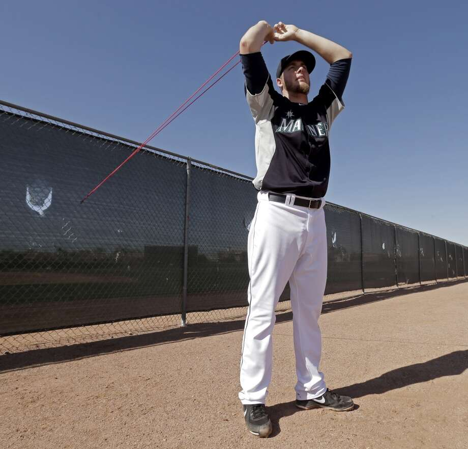 Mariners pitcher Brandon Maurer stretches before throwing during a spring training workout Tuesday in Peoria, Ariz.