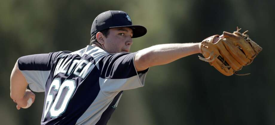Mariners pitcher Danny Hultzen throws during a spring training workout Tuesday in Peoria, Ariz.