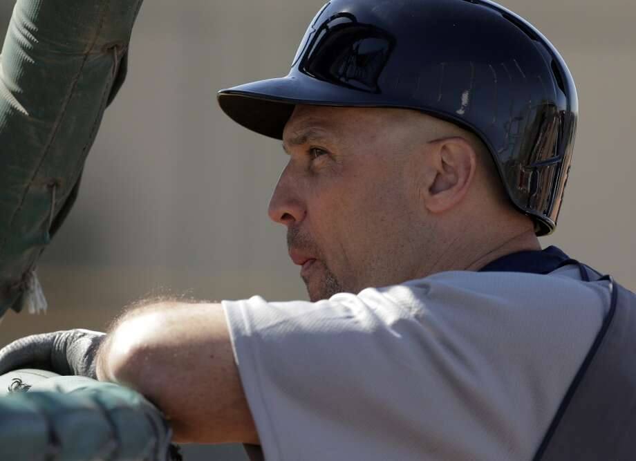 Mariners outfielder Raul Ibanez watches batting practice during a spring training workout Tuesday in Peoria, Ariz.