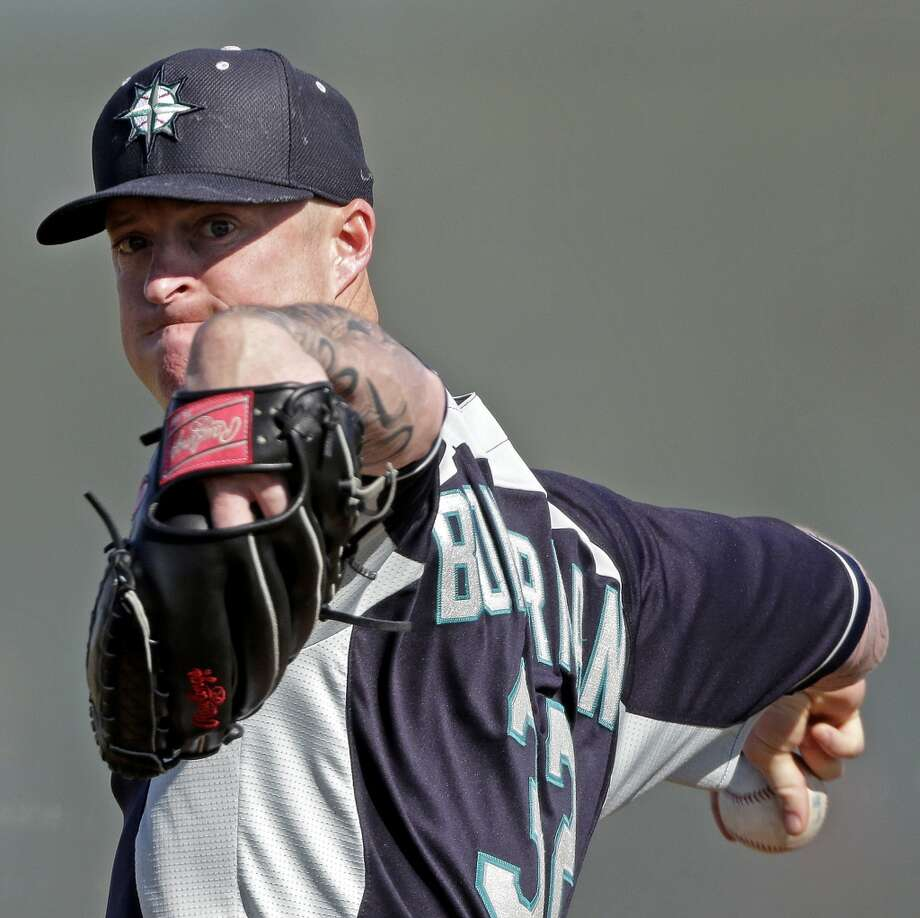 Mariners pitcher Jeremy Bonderman throws during a spring training workout Monday in Peoria, Ariz.