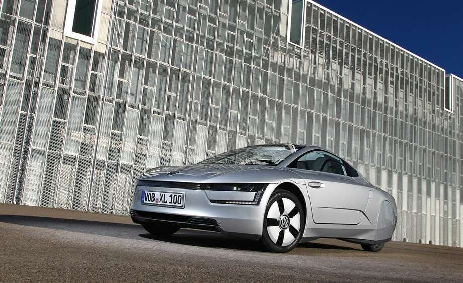 Volkswagen claims the XL1 is the most fuel-efficient production car in the world, with a combined fuel consumption rating of 261 mpg. The car can cover up to 32 miles as a zero-emissions vehicle in all-electric mode. Photo: Volkswagen