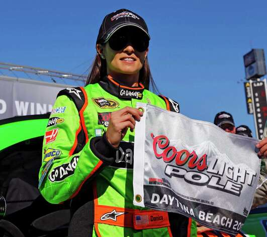 Danica Patrick displays the flag after winning the pole during qualifying for the NASCAR Daytona 500 Sprint Cup Series auto race at Daytona International Speedway, Sunday, Feb. 17, 2013, in Daytona Beach, Fla. Patrick won the pole, becoming the first woman to secure the top spot for any Sprint Cup race. Photo: Terry Renna