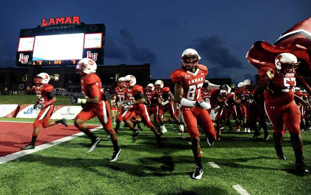 Lamar University football team charge the field before the Lamar University football game against McMurry University at Provost Umphrey Stadium on Saturday, October 13, 2012. Photo taken: Randy Edwards/The Enterprise