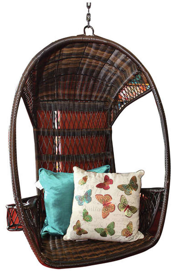 Swingsan ChairGo for a swing in this chair with an airy, open-weave back. Side compartments hold your drinks while a canopy provides shade. Weather-proof synthetic rattan that's been woven by hand over a sturdy, rust-resistant iron frame make this perfect for outdoors. $279.95, found at Pier 1.