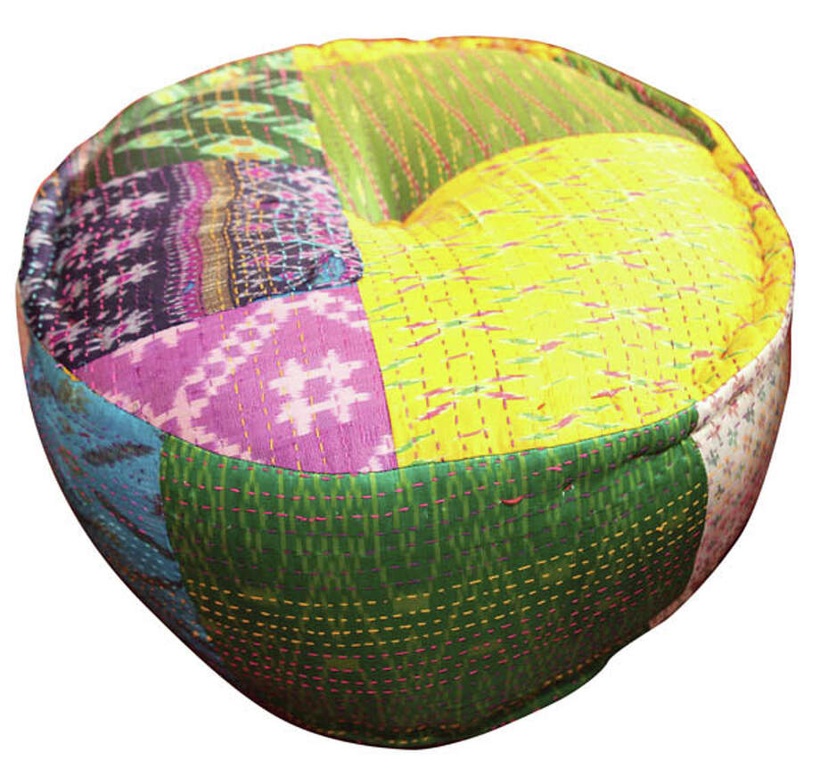 Ikat Pouf OttomanPut your feet up or take a seat on this vibrant pouf made of traditional Indian saris. $139.95, found at Pier 1.