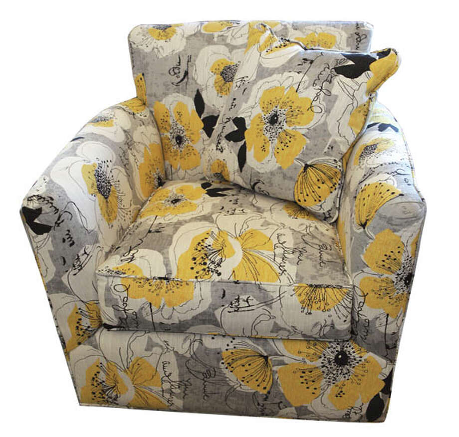 Oversized ChairThis Jonathan Louis chair will make any corner cozier. Features large floral pattern of golden ochre with heather gray background. $699. Found at Mooradians Furniture.