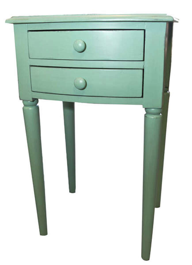 Square Side TableMake an accent statement with this Norwood Teal square table by Coast to Coast Imports. It features two drawers, tapered legs, an OG edge, a distressed finish and simple knobs. $179. Found at Mooradians Furniture.