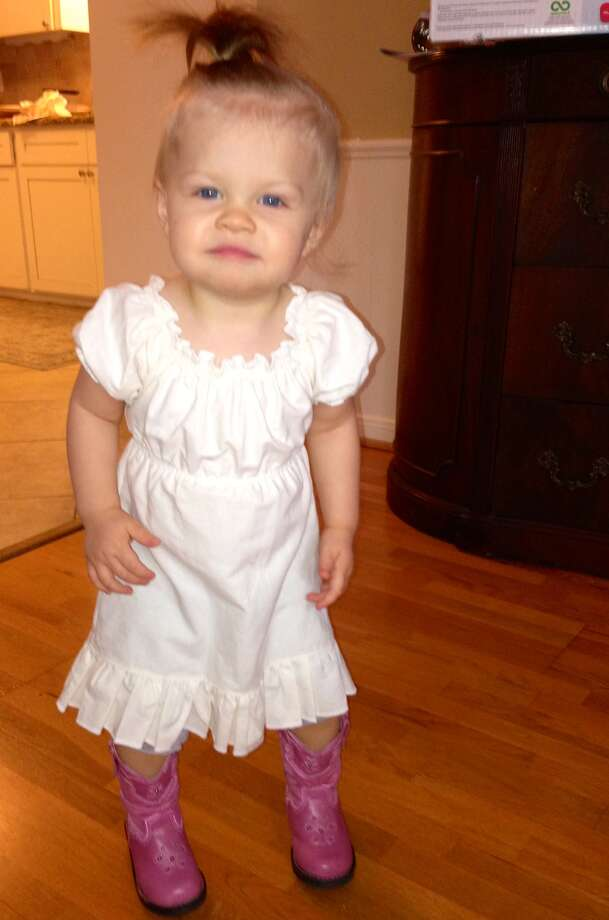 Genevieve, age 14 months, loves her pink cowgirl boots. Photo: Reader Submission