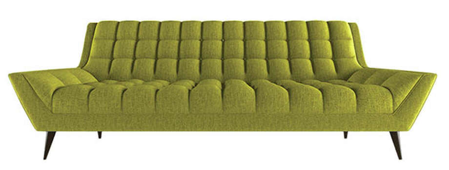 "Thrive Furniture, which makes its eco furniture in Los Angeles, Calif., created this amazing, retro-inspired piece called the ""Cleveland Sofa."" It is shown here in Klein Wheatgrass, but is available in a multitude of colors. $2,499. thrivefurniture.com"