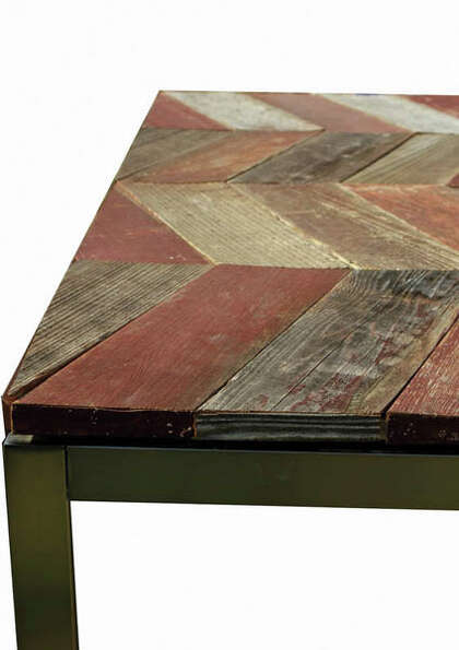 "Sitting on a brushed steel base topped with reclaimed wood, this coffee table had me at ""Chevron.�"