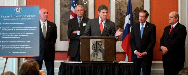Gov. Rick Perry, center,  holds a press conference at the Fort Worth Club to talk about the budget on Wednesday, Sept. 26, 2012, in Fort Worth, Texas.  Behind him are Texas legislators Eric Fox, Rice Tilley, Bill Zedler and Mark Shelton.   (AP Photo/The Fort Worth Star-Telegram, Jopyce Marshall )  MAGS OUT; (FORT WORTH WEEKLY, 360 WEST); Photo: Joyce Marshall, Associated Press / 00073462A Photo Assignment ID: