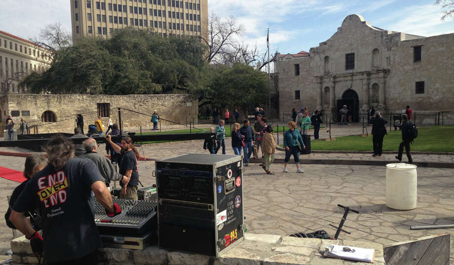 Crews set up audio/visual equipment Friday morning in front of the Alamo in preparation for the arrival of Travis' 'victory or death' letter.