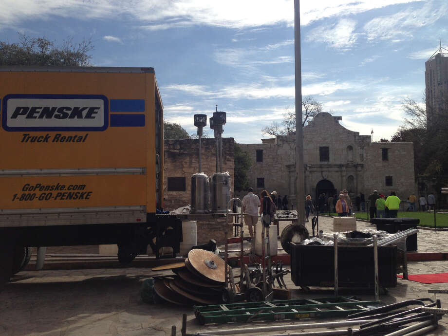 Crews set up equipment in front of the Alamo in preparation for the arrival of Travis' 'victory or death' letter.