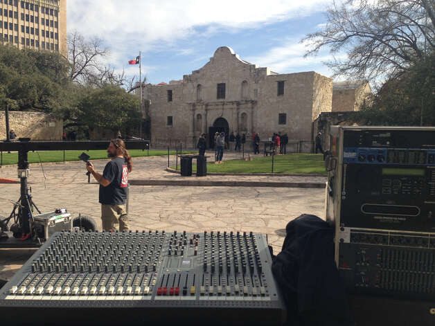 Crews set up audio/visual equipment in front of the Alamo in preparation for the arrival of Travis' 'victory or death' letter.