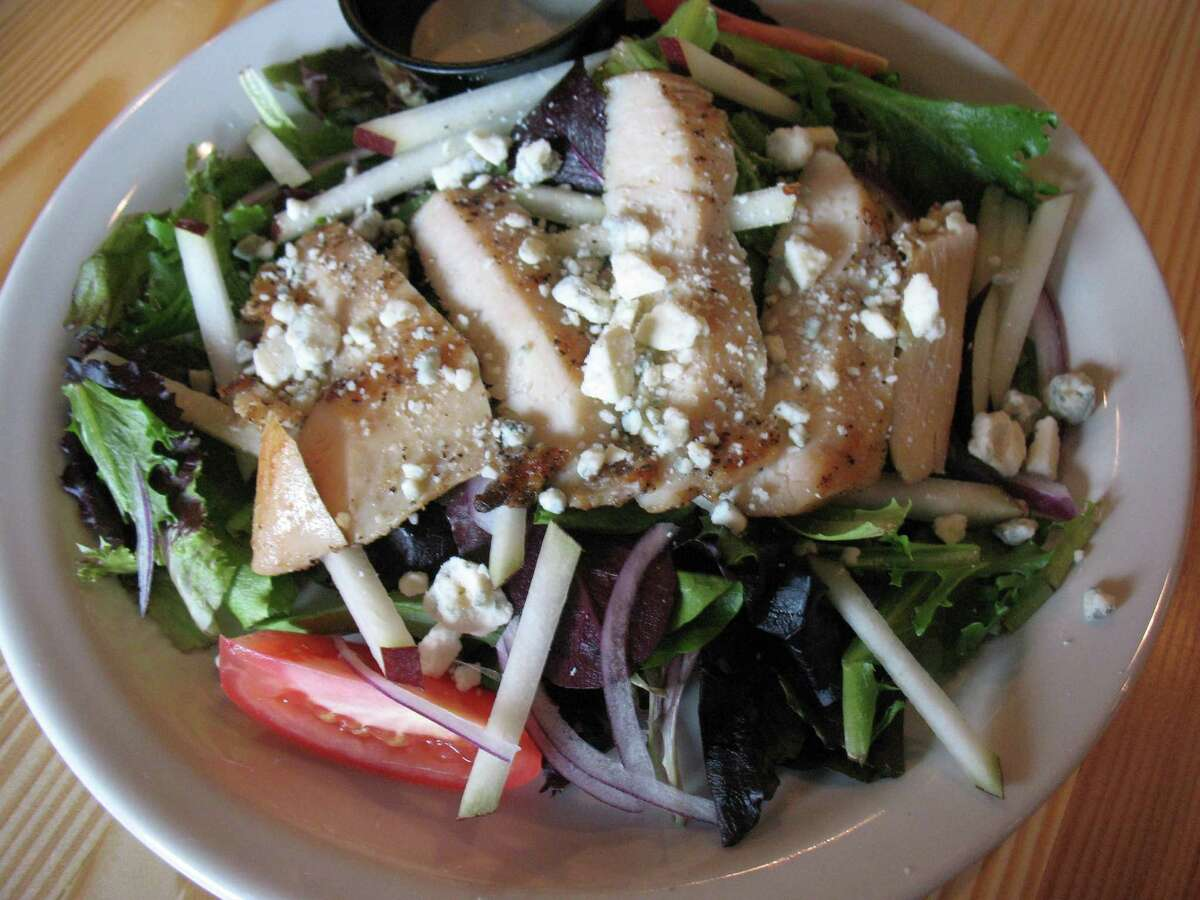 The Halcyon salad served with grilled chicken is one of the offerings at this new Southtown eatery. The Austin import is a coffee shop and a bar.