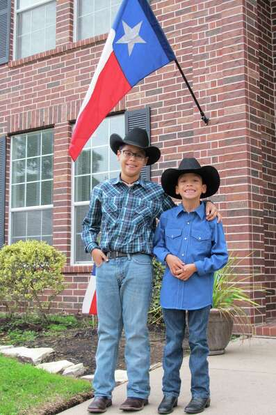 Two brothers showing true Texas spirit.