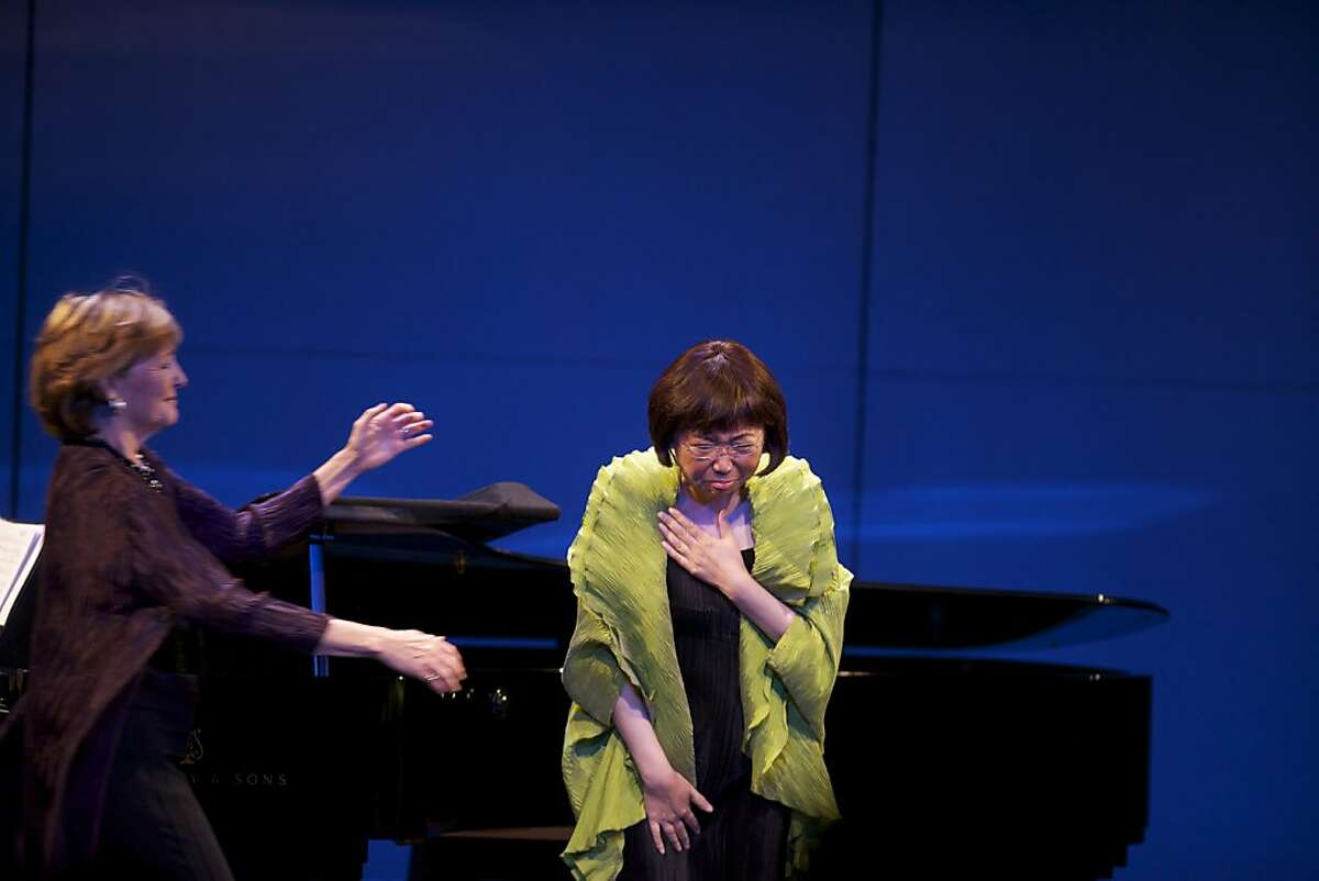 Frederica von Stade goes to hug Mezzo soprano Zheng Cao on Saturday, Dec. 3, 2011 in San Francisco after Cao told the audience that throughout her continuing battle with cancer, Flicka would come to the hospital and sing with her to keep her spirits up.