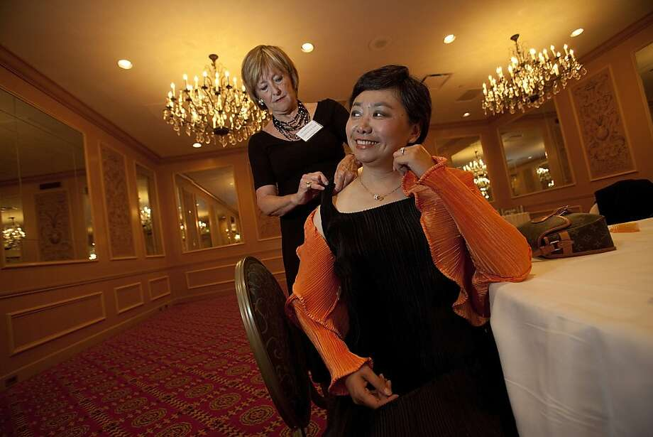 Zheng Cao, (right) a star with the San Francisco Opera has her dress mended by Frederica Von Stade (left) before singing at the opening night of the International Lung Cancer Conference gala at the Fairmont Hotel in 2009. Photo: David Paul Morris, Special To The Chronicle