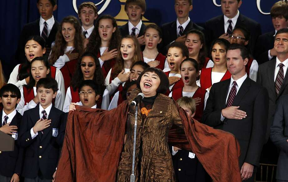San Francisco opera singer Zheng Cao sings the national anthem in front of the San Francisco Girls and Boys Chorus during the opening ceremonies of the Presidents Cup at Harding Park in  2009.--- Photo: Lance Iversen, The Chronicle