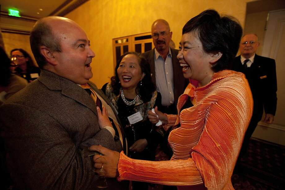 Zheng Cao, a star with the San Francisco Opera (right) shares a laugh with her Oncologist, Dr. Thierry Jahan and Jean Wang before singing at the opening night of the International Lung Cancer Conference gala at the Fairmont Hotel in 2009. Photo: David Paul Morris, Special To The Chronicle