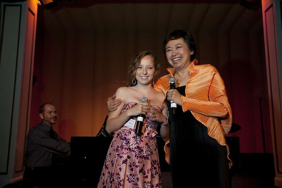 Zheng Cao, (right)  a star with the San Francisco Opera sings with Josy Jablons, 14 and Lynden Bair on the piano at the opening night of the International Lung Cancer Conference gala at the Fairmont Hotel in 2009. Photo: David Paul Morris, Special To The Chronicle