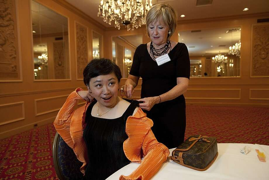Zheng Cao, (left) a star with the San Francisco Opera has her dress mended by Frederica Von Stade (right) before singing at the opening night of the International Lung Cancer Conference gala at the Fairmont Hotel in 2009. Photo: David Paul Morris, Special To The Chronicle