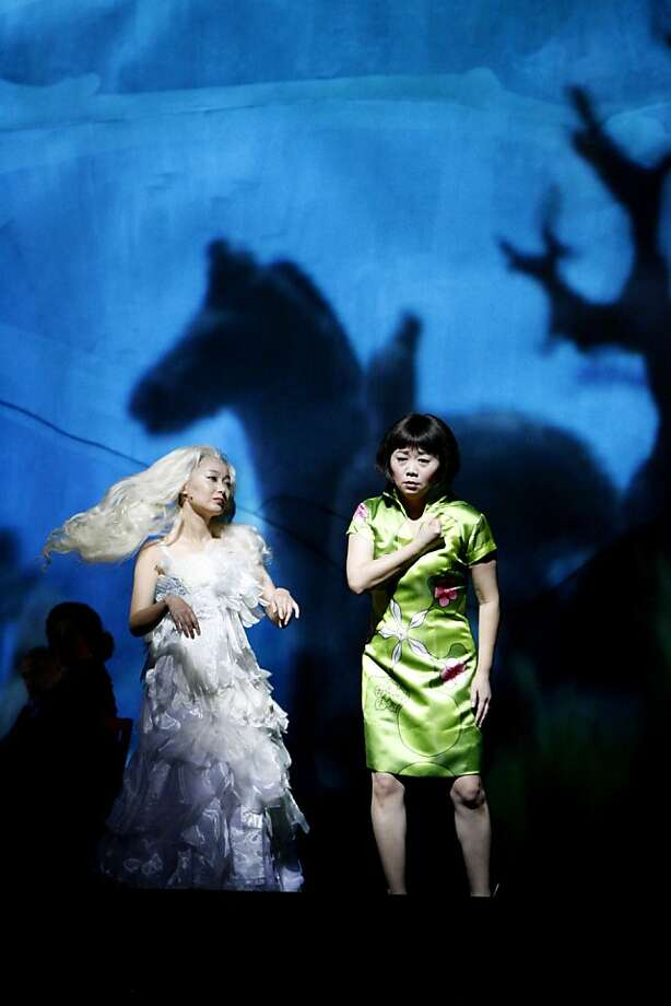 "Precious Auntie, played by Qian Yi, left, and Ruth Young Kamen, played by Zheng Cao, right, at the dress rehearsal of SF Opera's world premier of the opera based on the Amy Tan novel ""The Bonesetter's Daughter""  in San Francisco in 2008. Photo: Katy Raddatz, The Chronicle"