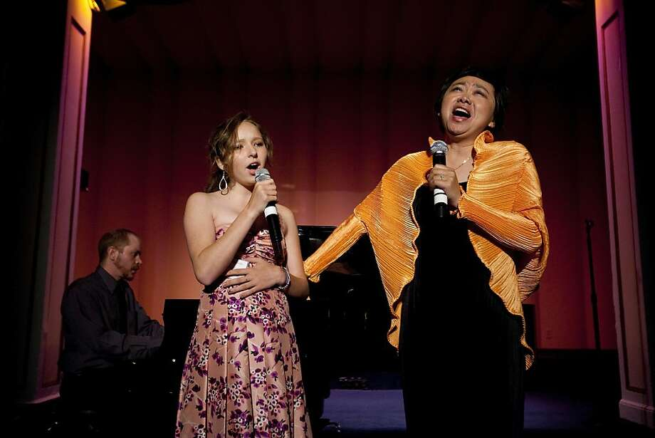 Zheng Cao, (right)  a star with the San Francisco Opera sings with Josy 