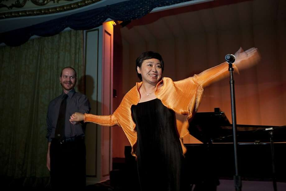 With the help of her pianist, Lynden Bair (left) Zheng Cao, a star with the San Francisco Opera, sings at the opening night of the International Lung Cancer Conference gala at the Fairmont Hotel in 2009. Photo: David Paul Morris, Special To The Chronicle
