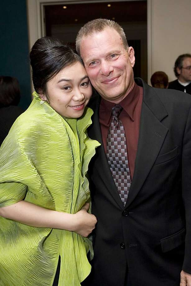 "Mezzo soprano Zheng Cao with San Francisco Opera General Director David Gockley at a private party Monday night to offer samples of the new opera ""The Bonesetter's Daughter"" in 2006. Photo: San Francisco Opera, SFC"