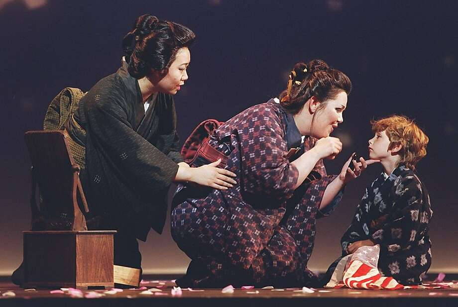 "Rosalind Sutherland as"" Madama Butterfly"" (center) prepares for the arrival of Lt. Pinkerton with her son and ""Suzuki"" played by Zheng Cao in 1997. Photo:  Peter Dasilva"