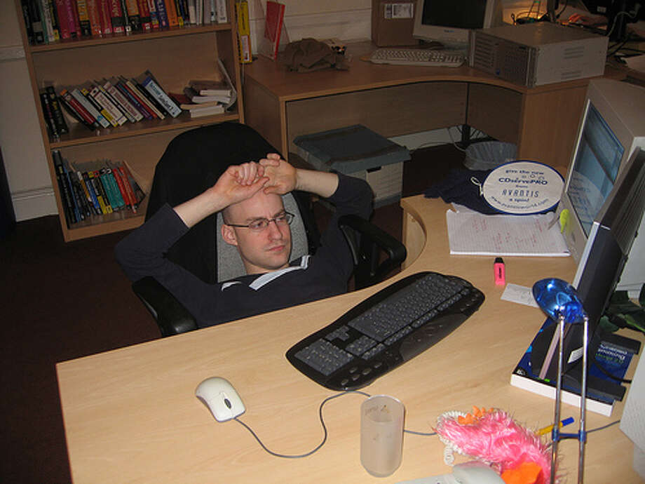 "Slouching at your desk: If your job requires you to sit most of the day, it's best if you get a sitting device that allows you to straighten your poor posture. If not, you're ""contributing to a pool of chronic, long-term ailments — including arthritis and bursitis."" (Photo: Robad0b, Flickr)